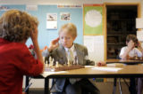 Neal Kornreich, cq, 9, Boulder, left, concentrates on his opponent Nate Bloom, cq, 9, Denver, as...