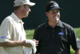 "Phil Mikelson smiles with his caddie Jim ""Bones"" Mackay during a Pro-Am at the 20th..."