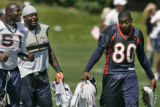 Denver Broncos' wide receiver, 80, Rod Smith, right, gets a little ribbing from linebackers, 51,...