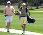Pro golfer Mark Wiebe walks with his son Gunner during the Colorado Golf Association's Junior...