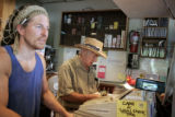 Isadore Million, cq, owner of Penny Lane, the venerable coffeehouse in Boulder counts money from...