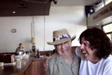 Isadore Million, cq, left, owner of Penny Lane, the venerable coffeehouse in Boulder, has a laugh...