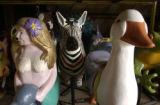 Some of the figures carved by Scott Harrison (cq) rest in a warehouse for the vintage carousel he...