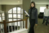 Castle Pines, CO Aug. 24 2005 Jessica Padilla, who started selling real estate in May, shows a...
