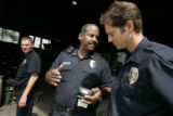 Denver fire station 10 crew inspects a business for fire safety.  Capt. Kevin 'slam' Duncan (c)...