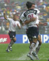 GRD107 - The United States' Josh Wolff, right, is embraced by his teammate Landon Donovan while...