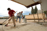 GRANBY, CO. JUNE 6, 2004) (lt. to rt.) Sasha Klein, of Granby helps Bob Haddock, of Granby,...