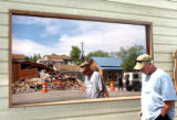 GRANBY, CO. JUNE 6, 2004) A demolished Gambles Store, which sold appliances, is reflected in a...