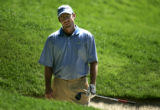 Last years' winner Rod Pampling reacts after hitting out of a bunker on the bth hole during the...