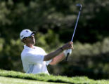 Jeff Brehaut hits an approach shot on the 18th hole during the final round at The International at...