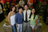 Fawn Luong(cq, second left), owner of the Vietnamese store Truong An, stands for a portrait with...
