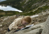 Aspen Brower, 10 years old from Lone Tree works on a water color paint at St. Mary's Glacier...