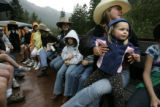 Sara Bradley, cq, 20, holds Lanet Dugan, cq, 3, from the Tumbling River Ranch on a sold out train...