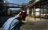 A worker walks past the production facility at Roche Pharmaceuticals in Boulder, Colo, as it...