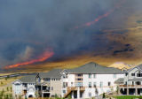 Golden, CO July 19, 2005 A fire on the west side of Table Mountain threatens new construction in...