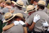 Rangers console one another following a memorial service for Rocky Mountain National Park Ranger...