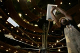 Electrician Dalan McDevitt (cq) assembles the Elizabeth Estey chandelier in the Ellie Caulkins...
