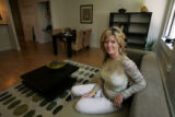 Portrait of Mona Fahmy (cq), Salesperson for St. Charles Town Company, in one of the condos at...