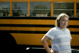 Brooke Mattson, 10, 5th grade, stands in front of a school bus at her school, Wyman Elementary. ...
