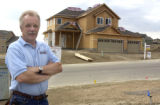 Owner Doug Collins of UBUILDIT  stands in front of a home he is building at 1713 Delores River...