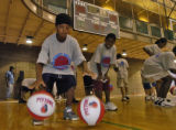 Verle Robinson (cq), age 13, and Kayree Gale-Warren (cq), age 10, (left to right,) work on ball...