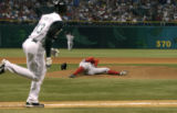 (07/26/2005 ST. PETERSBURG) Tampa Bay Devil Rays Carl Crawford (#13) watches while running to...