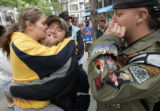 Bev Blake, cq, 19, left, hugs Mathew Morris, cq, 20, while hanging out on the 16th Street Mall on...