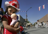 Aundreya Nace (cq), 3, of Cheyenne, WY., holds her doll while the Cheyenne Frontier Days Parade...