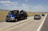 Jim Ringus (cq), of Chuck's Towing, hauls the 2004 Dodge Neon whos unidentified seventeen-year-old...