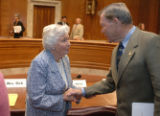 Mrs. Betty Dick shakes U.S. Sen. Craig Thomas's, R-Wy. hand, following Senate Subcommittee of...