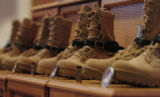Boots stand in honor of SFC Christopher Phelps(cq), SSG Jeremy Brown(cq), CPL Lyle Cambridge(cq),...