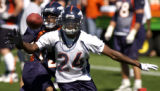 Denver Bronco corner back, Champ Bailey,right, breaks up a pass thrown to wide reciever, B.J....