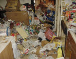 SH05G357HOARDING July 29, 2005 _ This hoarder's groceries and trash fill the floors and counters...