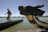Phil McLarnan, cq, Humboldt, Iowa, walks the rail of a Dragon Boat after launching it in Sloan's...