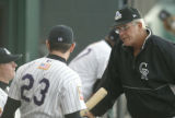 P.J. Carey, right, manager of the Casper Rockies, talks with his players, Steven Boggs, left, and...