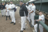 P.J. Carey, manager of the Casper Rockies, stands with his players during opening day festivities...