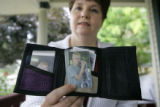 Tamara Hernandez (cq) of Montrose holds the wallet of her son, Adam, showing off a picture of a...