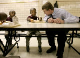 Denver Public Schools superintendent Michael Bennet talks with kindergartner Tevya Lassiter (cq),...