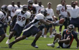 Denver Broncos' linebacker, 54, Patrick Chukwurah, center, pulls down an interception intended for...
