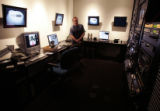 Ron Metz, (cq) a post production supervisor, inputs media at the Cer Central Control room  at High...