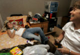 Molly Rosenberg (cq), 18, left, takes a break from unpacking to lay down on her new bed while her...
