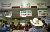 Simon Uribe, of Durango, Mexico, buys a 7:30 p.m. bus ticket to Denver at the Limousine Express...