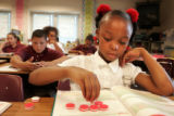 Maxwell Elementary School 5th grader Tayteon Lewis, cq,  works on a math exercise in...