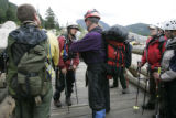 Park ranger Brian Hasebe (cq) ( Face to camera, wearing white helmet ) briefs search and rescue...