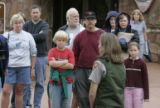 Visitors at the Beaver meadows Visitor Center listen to IPark Informational Officer Kyle Patterson...