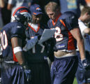 Denver Broncos' wide receiver, 19, Jerry Rice, center, runningback, 20, Maurice Clarett, left, and...