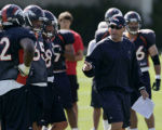 FILE- Denver Broncos' tight end coach, Tim Brewster, right, gives instructions to tight end, 82,...