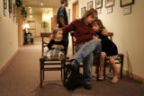 Melissa Wells, cq, holds her daughters Nadia Couch, cq, left, 18 months, and Lilly Alexander, 6,...