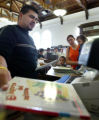 (Denver County, Colo., August 4, 2005) Circulation clerk Ruben Terrones, left, checks out Spanish...