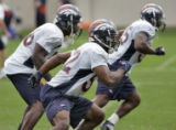 FILE-Denver Broncos' linebackers 52, Ian Gold, front, 56, Al Wilson, center and 55, D.J. Willams,...